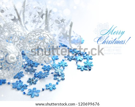 Christmas festive background with silver and blue baubles