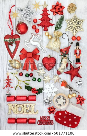 Christmas festive decorations with gold noel sign, old fashioned and new baubles, holly, mistletoe, fir and  mince pie on rustic white wood background. #681971188