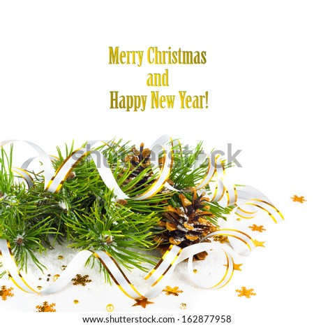 Christmas fir branch with pine cones, gold streamers and stars on a white background isolated - Shutterstock ID 162877958