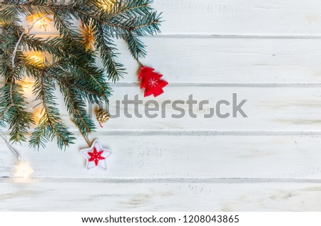 Christmas fir tree branches on white rustic wooden background with copy space for text. Christmas background. #1208043865