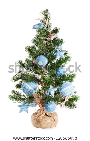 Christmas fir tree decorated with toys and Christmas decorations isolated on white background