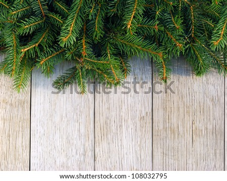 Christmas fir tree on a wooden board