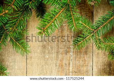 christmas fir tree on rustic wooden board