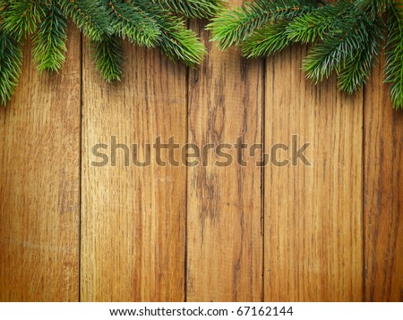 Christmas fir tree on the wooden board