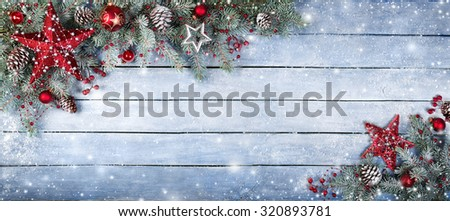 Christmas Fir Tree On Wooden Background With Snowflakes  #320893781