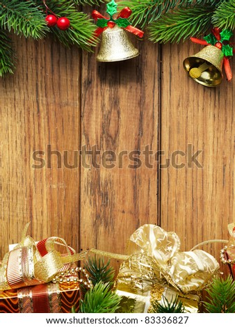 Christmas fir tree with christmas decoration on wooden board