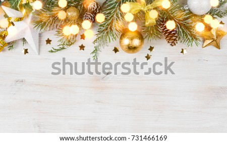 Christmas fir tree with decoration and glitters on wooden background #731466169