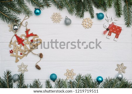 Christmas fir tree with decoration and glitters on wooden background. Christmas background on the white wooden desk #1219719511
