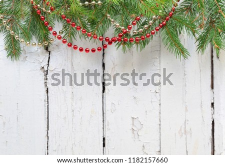 Christmas fir tree with decoration on a wooden board. #1182157660