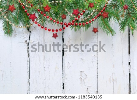 Christmas fir tree with decoration on a wooden board. #1183540135