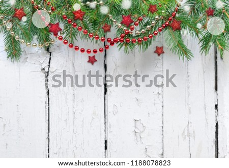 Christmas fir tree with decoration on a wooden board #1188078823