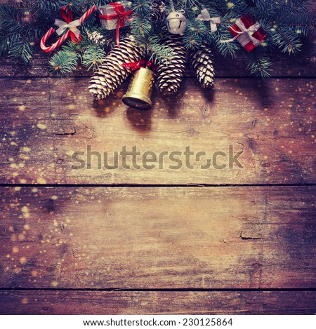 Christmas fir tree with decoration on dark wooden board