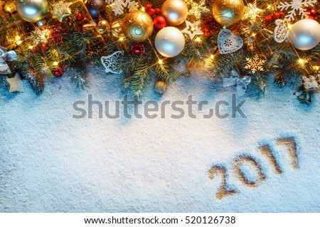 Christmas fir tree with decoration on snowy background. Merry Christmas and Happy New Year!! Top view.