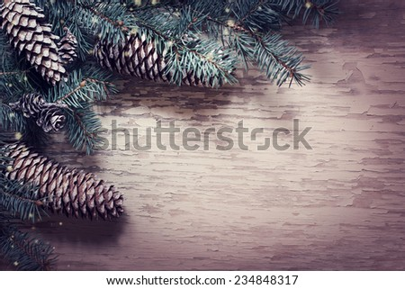 Christmas fir tree with decorations on wooden board
