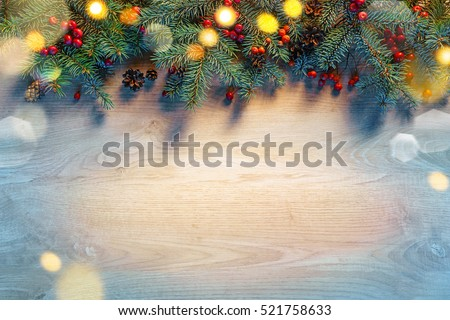 Christmas fir tree with lights on wooden background. Merry Christmas and Happy New Year!! Top view.  #521758633