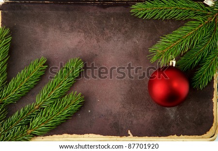 Christmas fir tree with old paper and christmas decorations