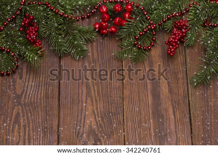 Christmas fir tree with snow on wooden background #342240761