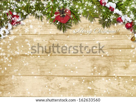 Christmas fir tree with snowfall on a wooden board  #162633560