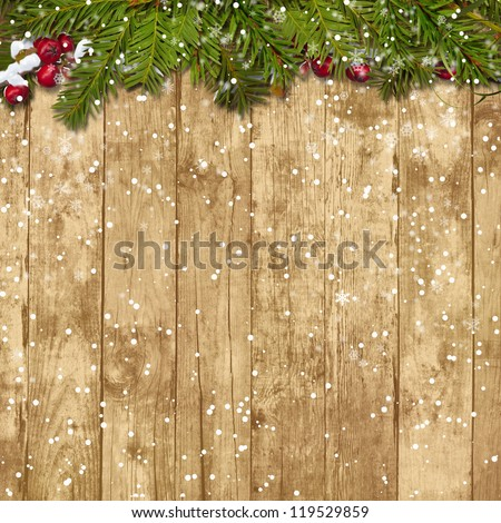 Christmas fir twig with red berries on the wooden background #119529859