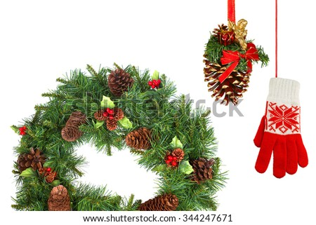 Christmas fir wreath, pine cone and mittens on a white background #344247671