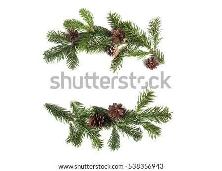 Christmas flat lay composition of fir branches and pine cones with copy space for text.  Top view on white background