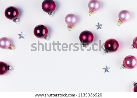 Christmas flat lay scene with pink abd violet glass balls, copy space on white table #1135036520