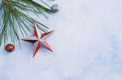 Christmas flat lay with star decoration by jingle bells and pine branch, holiday celebration with shallow depth of field on blurred background.  Copy space for seasonal card.