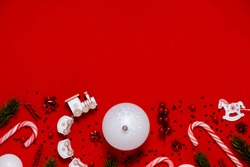 Christmas flatlay background presents, christmas balls and stars. Top horizontal view copyspace red background.New year and christmas concept