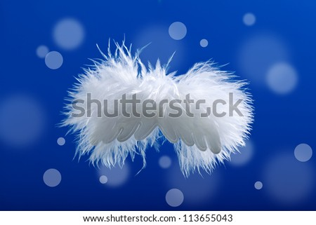 Christmas fluffy angel against blurry lights