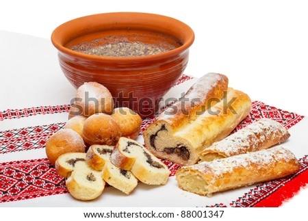 Christmas food in Ukraine - kutya, donuts and cakes with marzipan and poppy seeds