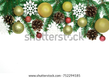 Christmas frame background from xmas tree and golden balls isolated on the white table and copy space for holiday text. #752294185