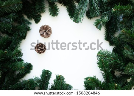 Christmas frame background with xmas tree and xmas decorations. Merry Christmas greeting card, banner. Winter holiday theme. Happy New Year. Space for text