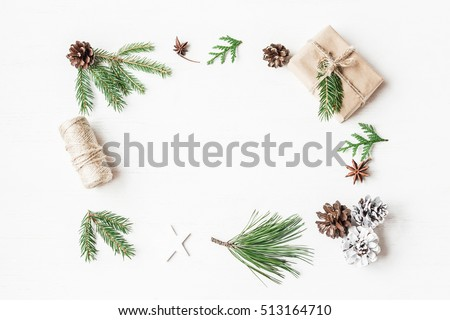 Christmas frame. Christmas gift, pine cones, fir branches. Top view, flat lay