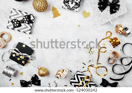 Christmas frame. Christmas gifts, bows, decor. Flat lay, top view #524030242