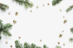 Christmas frame. Spruce branches, Christmas balls and beads. Preparation for the New Year. Christmas background for presentation of work or text. Flat lay, top view, copy space,  mock-up
