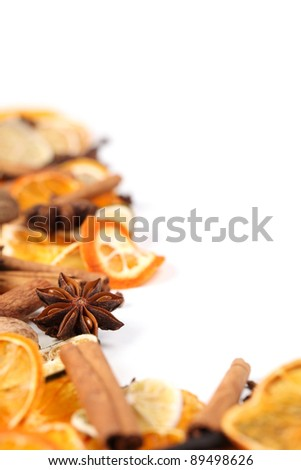 Christmas frame with Christmas spices and dried orange slices isolated on white background