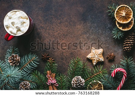 Christmas frame with hot chocolate, spices, candy cane, fir tree and gingerbread cookies. Copy space for text. Christmas wallpaper, card, background or design mock up #763168288
