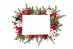 Christmas frame with santa claus, snowman and angel decorations, viburnum berries, wooden snowflakes and confetti. Merry Christmas background for design template or mockup with copy space.
