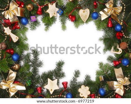 Christmas framework made of fir branches and various decorations with white copy space