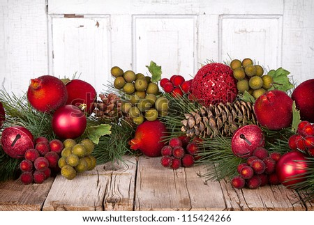 Christmas Fruit and ornaments with pine branches on a wooden background