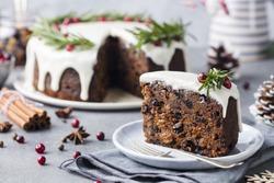 Christmas fruit cake, pudding on white plate. Christmas decoration. Close up.