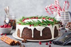 Christmas fruit cake, pudding on white plate. Close up. Copy space.