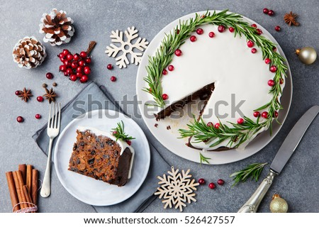 Christmas fruit cake, pudding on white plate. Copy space. Top view