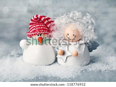 Christmas fun decorative figurines on a snowy background .Christmas card.