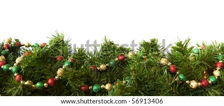 Christmas garland decorated with a string of festive baubles, over white background.