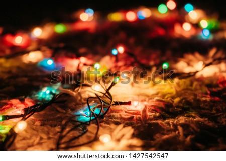Christmas garland glows on the floor #1427542547