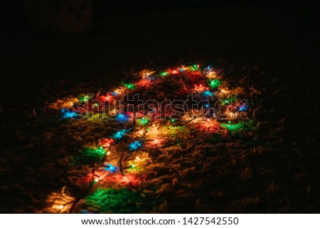 Christmas garland glows on the floor #1427542550