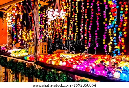 Christmas garlands and toys market scene. Merry Christmas and Happy New Year shop scene. Glowing garlands in Merry Christmas market. Happy New Year glowing garlands shop