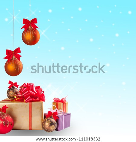 Christmas gift and balls with snow on festive background