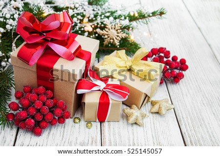 christmas gift box and decorations on a old wooden background - Christmas Gift Box Decorations